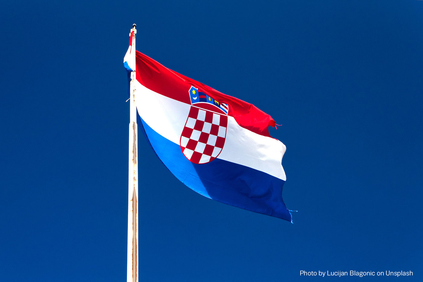 Croatian flag on blue sky background