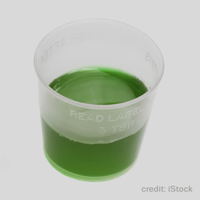 medicine cup with green methadone