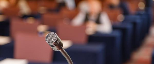 microphone on blurred meeting audience