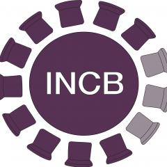 logo incb purple chairs in a circle with table at the centre